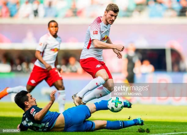 Leipzig's German forward Timo Werner and Hoffenheim's German defender Benjamin Huebner vie for the ball during the German first division Bundesliga...
