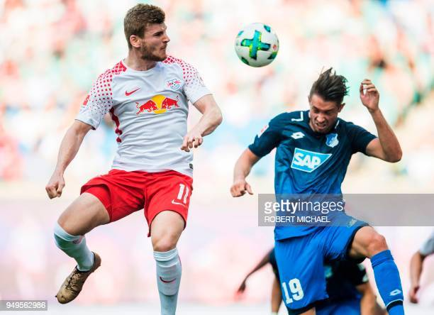 Leipzig's German forward Timo Werner and Hoffenheim's German forward Mark Uth vie for the ball during the German first division Bundesliga football...