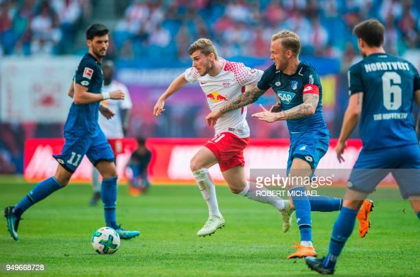 Leipzig's German forward Timo Werner and Hoffenheim's German midfielder Kevin Vogt vie for the ball during the German first division Bundesliga...