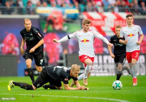 Leipzig's German forward Timo Werner and Stuttgart's German defender Timo Baumgartl vie for the ball during the German first division Bundesliga...