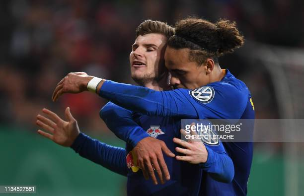 Leipzig's German forward Timo Werner celebrates scoring the opening goal with his teammate Danish forward Yussuf Poulsen during the German Cup...