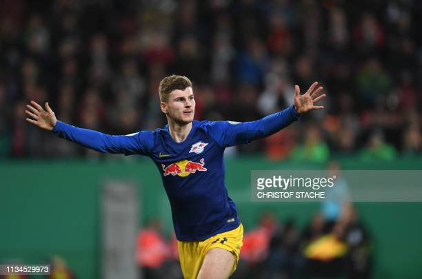 Leipzig's German forward Timo Werner celebrates scoring the opening goal during the German Cup quarterfinal football match Augsburg v RB Leipzig on...