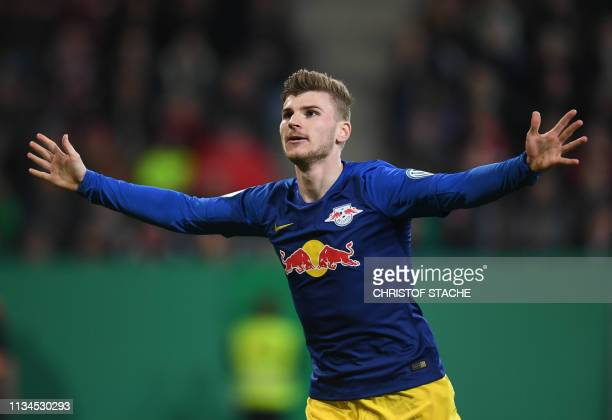 Leipzig's German forward Timo Werner celebrates scoring the opening goal during the German Cup quarter-final football match Augsburg v RB Leipzig on...