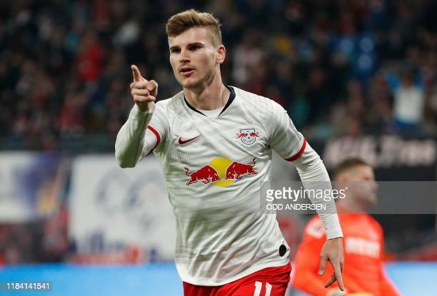 Leipzig's German forward Timo Werner celebrates scoring the opening goal during the German first division Bundesliga football match RB Leipzig v FC...