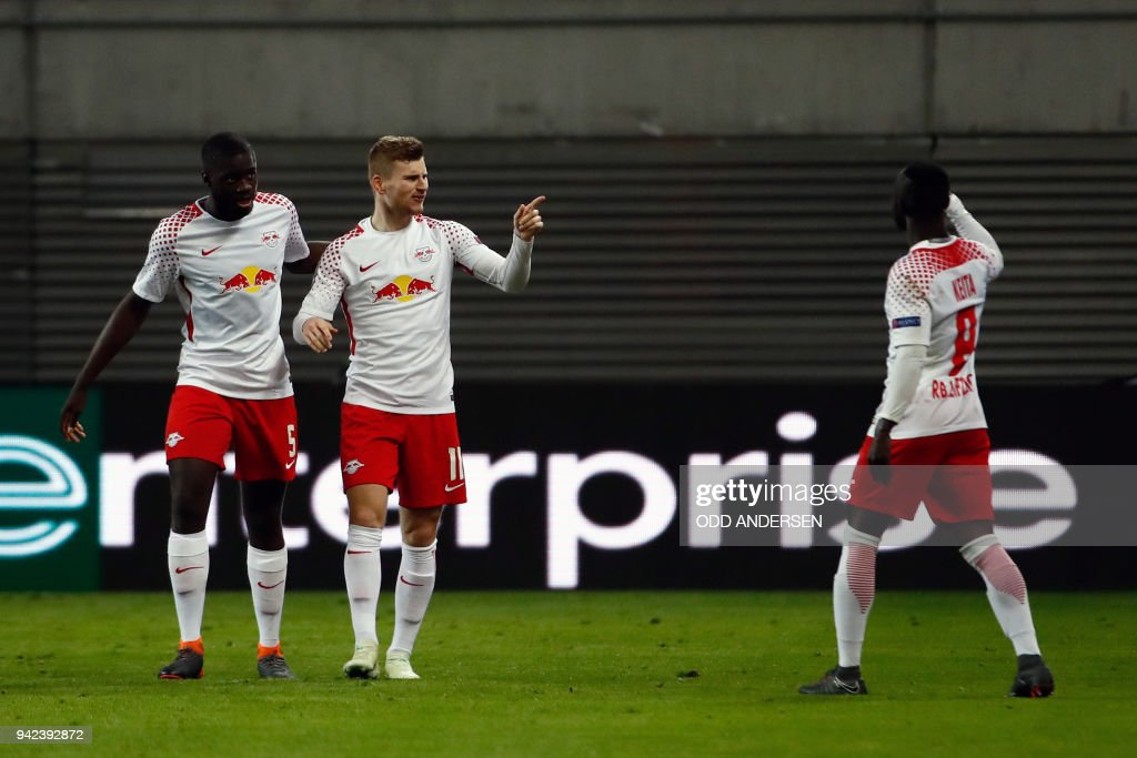 Leipzig's German forward Timo Werner (C) celebrates scoring the opening goal with his teammates during the UEFA Europa League quarter-final first leg football match RB Leipzig vs Olympique de Marseille (OM) at the RB arena in Leipzig, eastern Germany, on April 5, 2018. / AFP PHOTO / Odd ANDERSEN