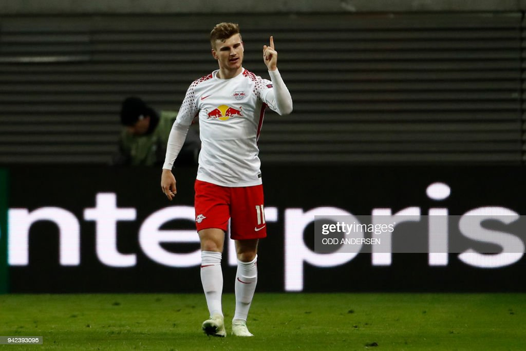 Leipzig's German forward Timo Werner celebrates scoring the opening goal during the UEFA Europa League quarter-final first leg football match RB Leipzig vs Olympique de Marseille (OM) at the RB arena in Leipzig, eastern Germany, on April 5, 2018. / AFP PHOTO / Odd ANDERSEN