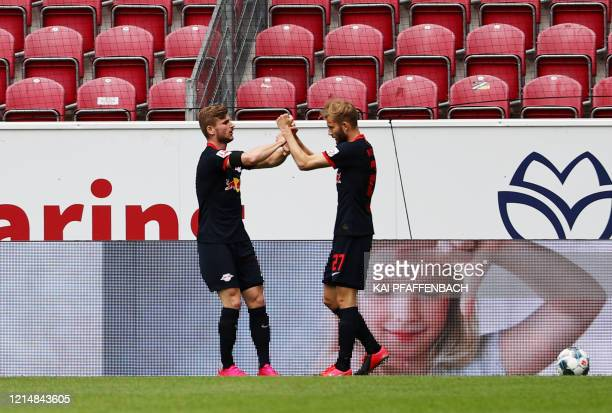 Leipzig's German forward Timo Werner celebrates scoring with Leipzig's Austrian midfielder Konrad Laimer during the German first division Bundesliga...