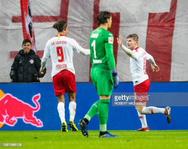 Leipzig's German forward Timo Werner celebrates with his teammate Leipzig's Danish forward Yussuf Poulsen after scoring the second goal past...
