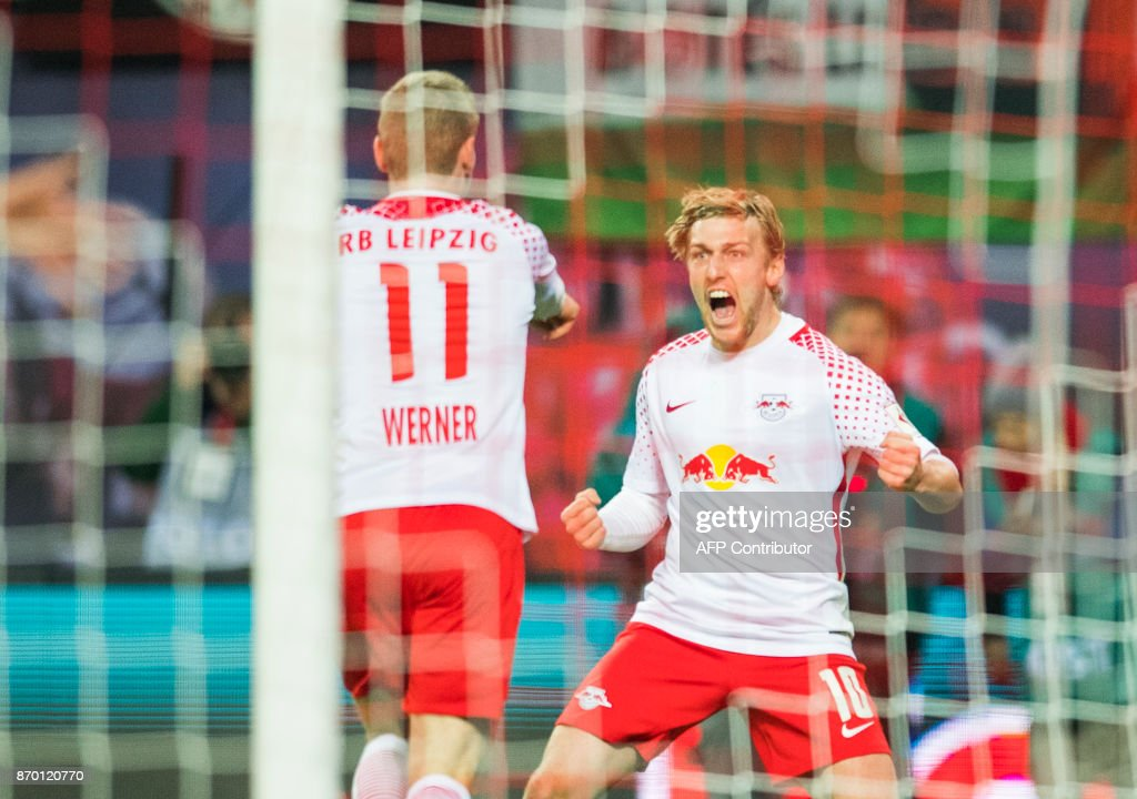 TOPSHOT - Leipzig's German forward Timo Werner (L) celebrates with his teammate Leipzig's Swedish midfielder Emil Forsberg after scoring during the German first division Bundesliga football match RB Leipzig vs Hannover 96 in Leipzig, eastern Germany, on November 4, 2017. /