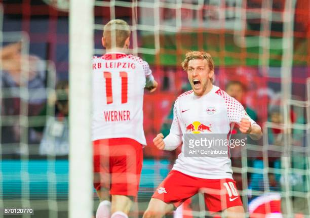 TOPSHOT Leipzig's German forward Timo Werner celebrates with his teammate Leipzig's Swedish midfielder Emil Forsberg after scoring during the German...