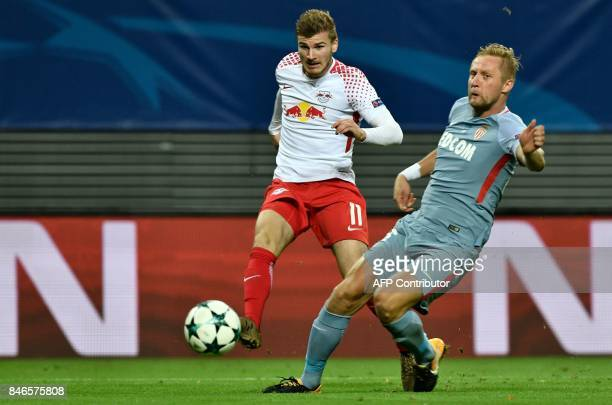 Leipzig's German forward Timo Werner gets a shot past Monaco's Polish defender Kamil Glik during the UEFA Champions League group G football match RB...