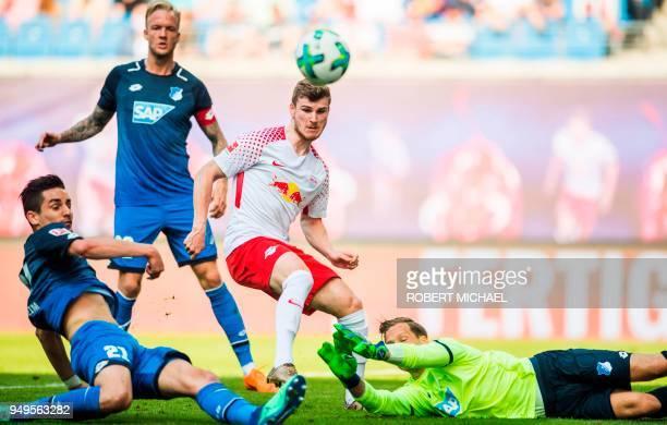 Leipzig's German forward Timo Werner Hoffenheim's German defender Benjamin Huebner Hoffenheim's German midfielder Kevin Vogt and Hoffenheim's German...