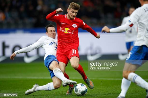 Leipzig's German forward Timo Werner is tackled by Hertha Berlin's Czech midfielder Vladimir Darida during the German first division Bundesliga...