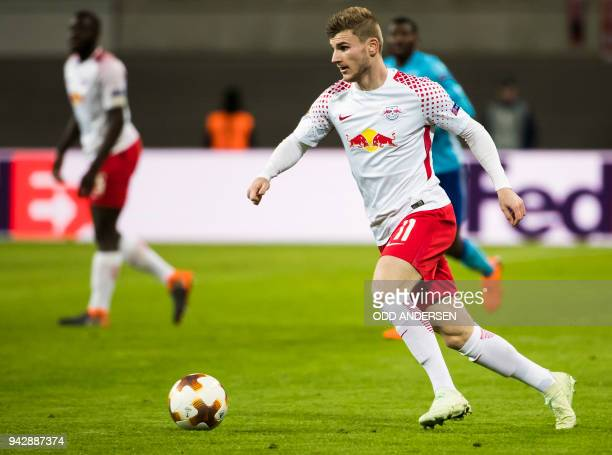 Leipzig's German forward Timo Werner runs with the ball during the Europa League quarter final first leg football match RB Leipzig vs Olympique de...