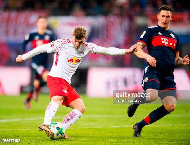 Leipzig's German forward Timo Werner scores next to Bayern Munich's German defender Niklas Suele during the German first division Bundesliga football...