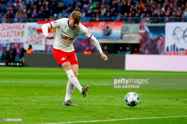 Leipzig's German forward Timo Werner shoots to score during the German first division Bundesliga football match RB Leipzig v Hoffenheim in Leipzig on...