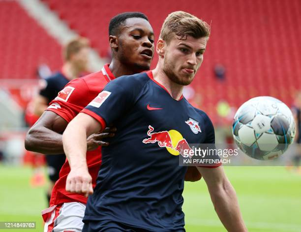 Leipzig's German forward Timo Werner vies with Mainz' German midfielder Ridle Baku during the German first division Bundesliga football match FC...