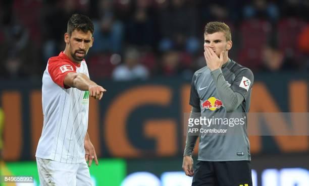 Leipzig's German forward Timo Werner wipes his face beside Augsburg's German midfielder Rani Khedira during the German First division Bundesliga...