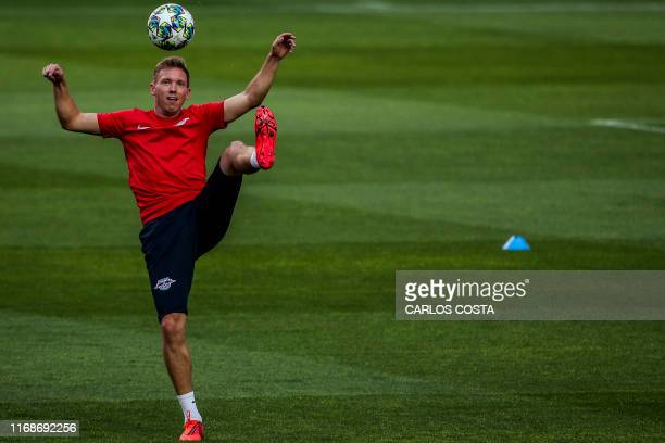 TOPSHOT Leipzig's German head coach Julian Nagelsmann attends a training session at the Luz Stadium in Lisbon on September 16 on the eve of the UEFA...