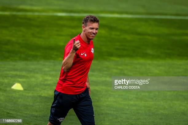 Leipzig's German head coach Julian Nagelsmann gesures during a training session at the Luz Stadium in Lisbon on September 16 on the eve of the UEFA...