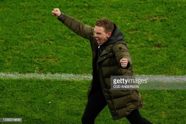 Leipzig's German headcoach Julian Nagelsmann celebrates at the finale whistle of the UEFA Champions League Group H football match RB Leipzig v...