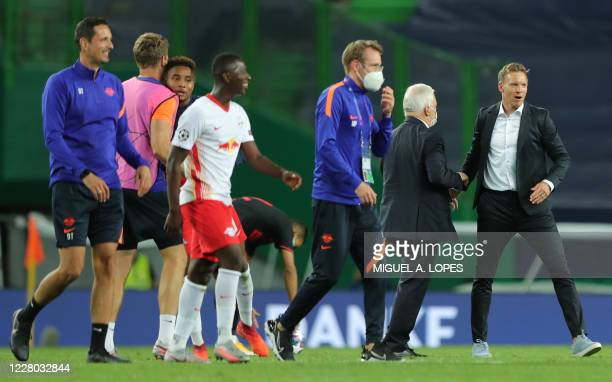 Leipzig's German headcoach Julian Nagelsmann celebrates his team's win at the end of the UEFA Champions League quarter-final football match between...