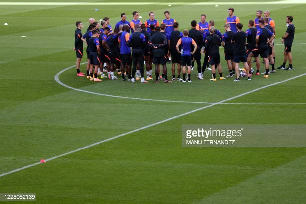 Leipzig's German headcoach Julian Nagelsmann talks to players during a training session at the Luz stadium in Lisbon on August 17, 2020 on the eve of...