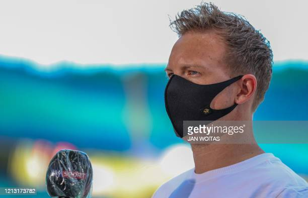 Leipzig's German headcoach Julian Nagelsmann wears a face mask as he gives an interview prior to the German first division Bundesliga football match...