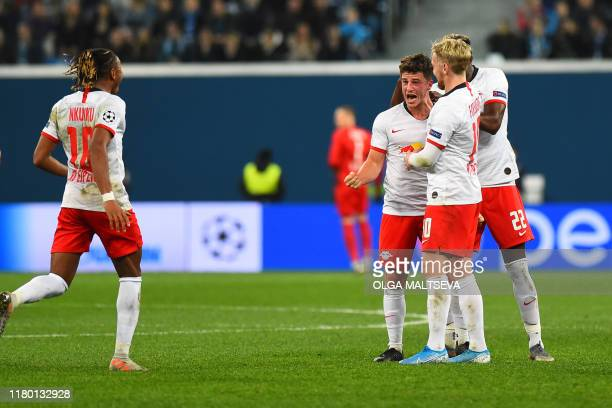 Leipzig's German midfielder Diego Demme celebrates with teammates after scoring a goal during the UEFA Champions League group G football match...