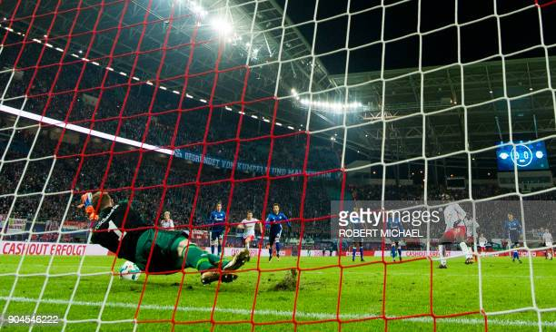 Leipzig´s goalkeeper Ralf Faehrmann saves the penalty kick by Leipzig´s French forward JeanKevin Augustin during the German first division Bundesliga...