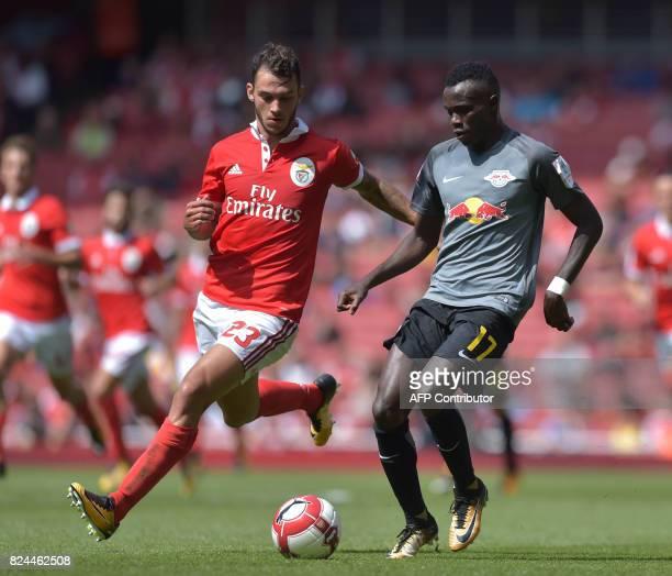 Leipzig's GuineaBissauborn Portuguese midfielder Bruma vies with Benfica's Portuguese defender Pedro Pereira during the preseason friendly football...