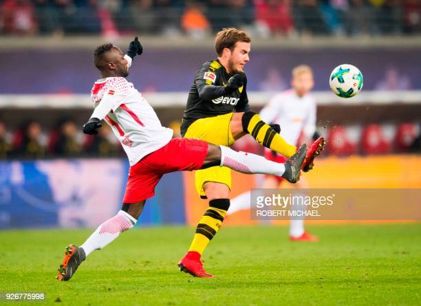 Leipzig´s Guinean midfielder Naby Deco Keita and Dortmund´s midfielder Mario Goetze vie for the ball during the German first division Bundesliga...