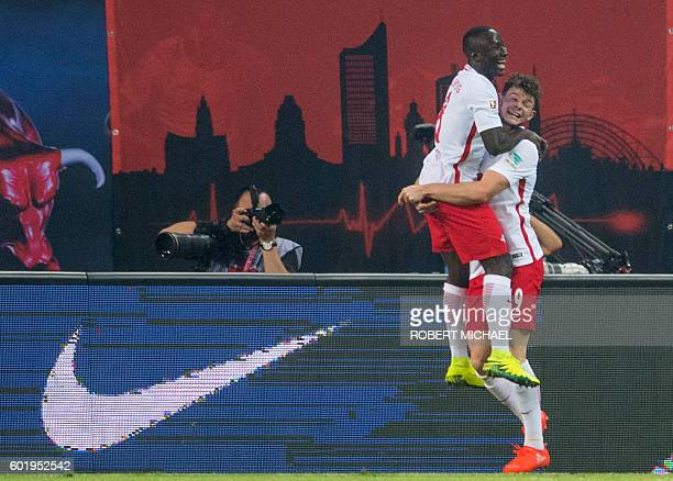 Leipzig´s Guinean midfielder Naby Deco Keita celbrates after scoring the first goal with his teamate Leipzig's Scottish midfielder Oliver Burke...