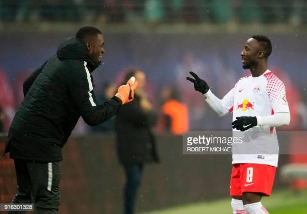 Leipzig´s Guinean midfielder Naby Deco Keita celebrates scoring with Swiss goalkeeper Yvon Mvogo from Switzerland during the German first division...
