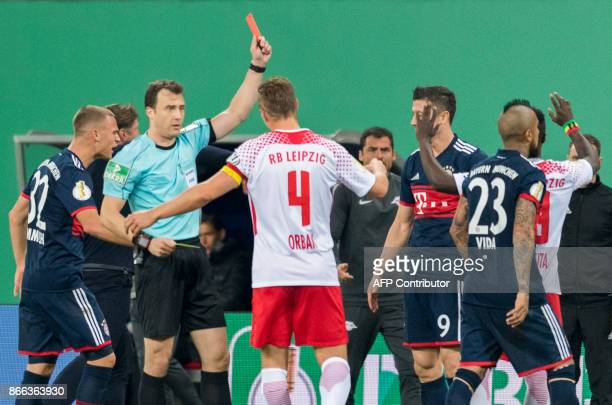 Leipzig´s Guinean midfielder Naby Deco Keita recives the red card from referee Felix Zwayer during the German Cup football match RB Leipzig v FC...