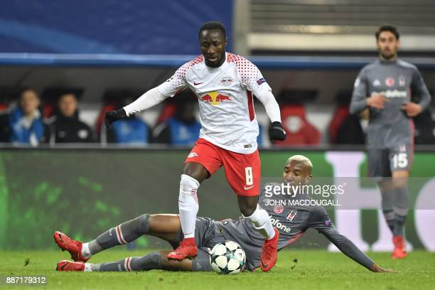 Leipzig's Guinean midfielder Naby Keita and Besiktas' Brazilian midfielder Talisca vie for the ball during the UEFA Champions League group G football...
