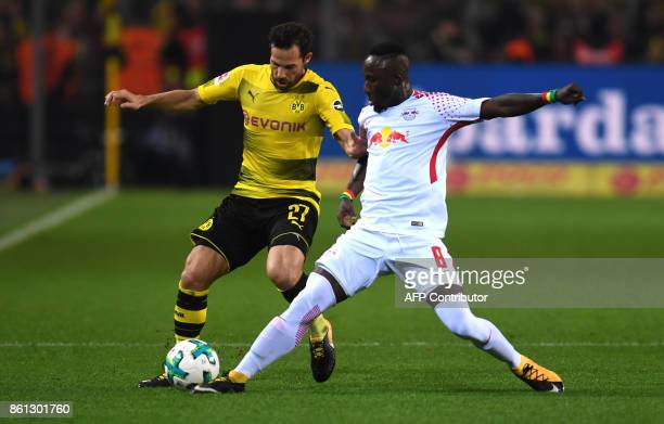 Leipzig's Guinean midfielder Naby Keita and Dortmund's midfielder Gonzalo Castro vie for the ball during the German first division Bundesliga...