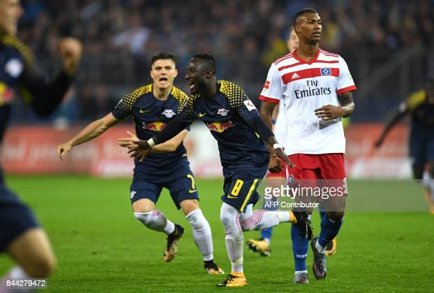 Leipzig's Guinean midfielder Naby Keita and his teammates celebrates after scoring during German first division Bundesliga football match between...