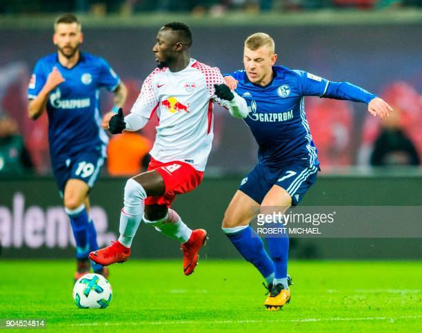 Leipzig´s Guinean midfielder Naby Keita and Schalke´s midfielder Max Meyer vie for the ball during the German first division Bundesliga football...