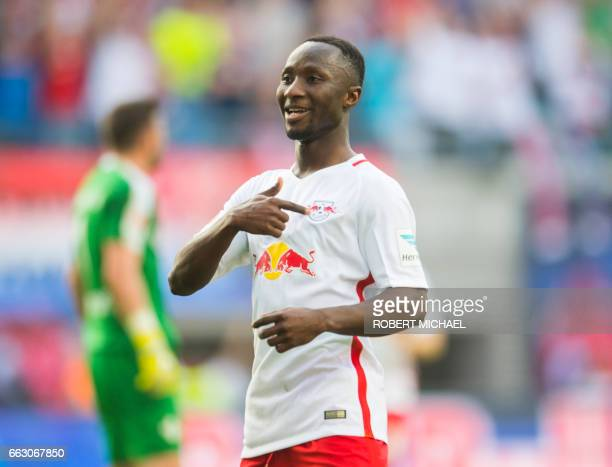 Leipzig's Guinean midfielder Naby Keita celebrates after scoring the 40 during the German first division Bundesliga football match between RB Leipzig...