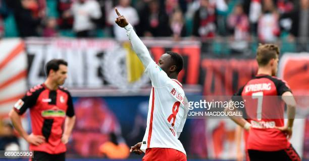 Leipzig's Guinean midfielder Naby Keita celebrates after scoring the third goal during the Bundesliga match RB Leipzig vs SC Freiburg in Leipzig on...