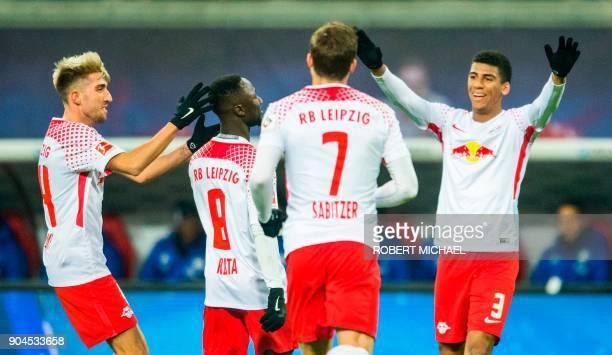 Leipzig´s Guinean midfielder Naby Keita celebrates scoring with his teammates Slovanian midfielder Kevin Kampl Austrian forward Marcel Sabitzer and...