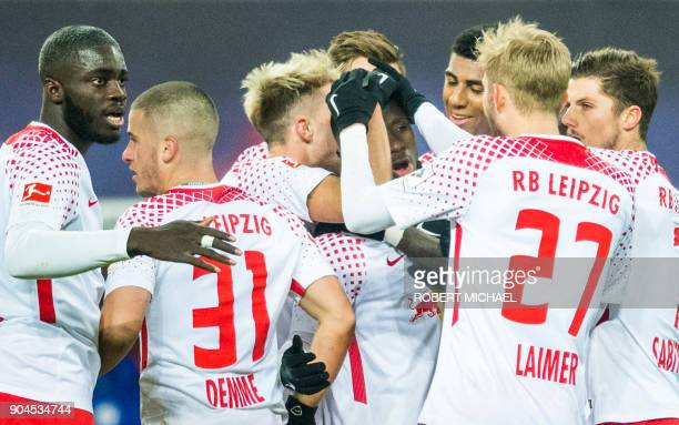 Leipzig´s Guinean midfielder Naby Keita celebrates scoring with his teammates during the German first division Bundesliga football match between RB...