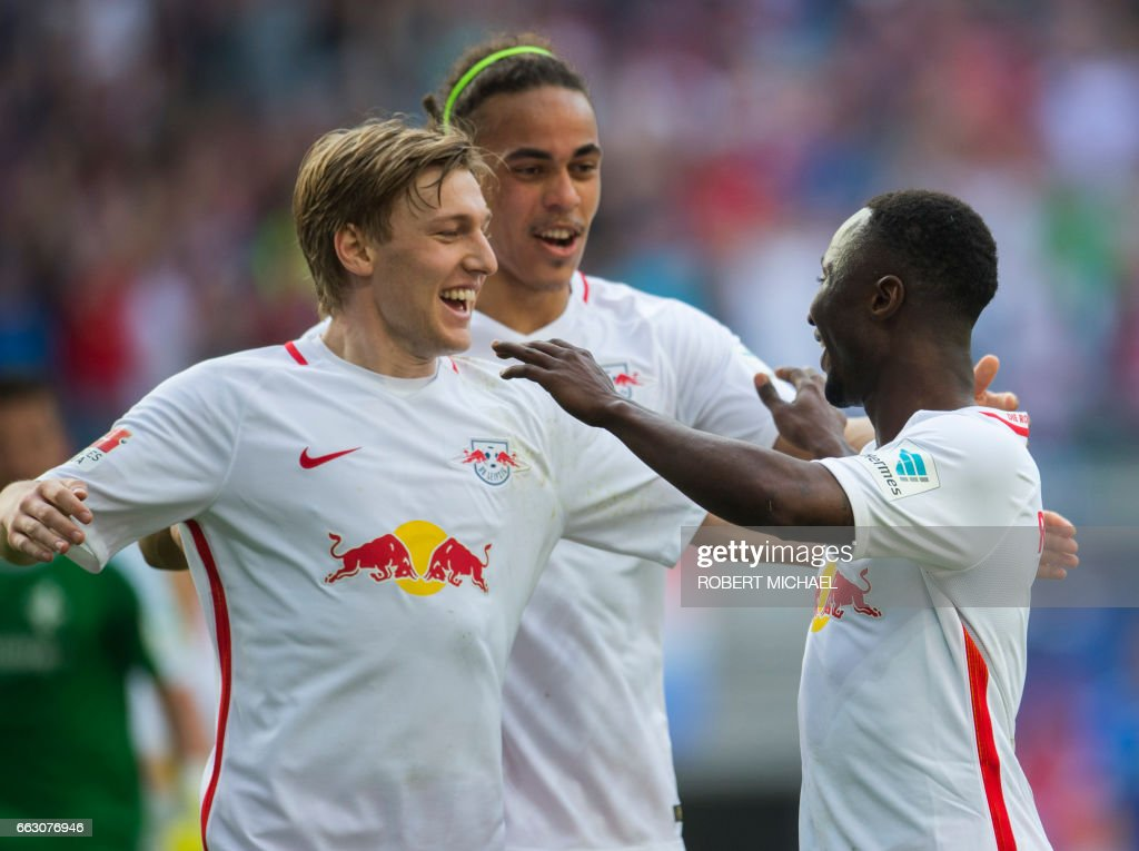 Leipzig's Guinean midfielder Naby Keita (R) celebrates with his teammates Swedish forward Emil Forsberg (L) and Danish forward Yussuf Poulsen (C) after scoring the 4-0 during the German first division Bundesliga football match between RB Leipzig and SV Darmstadt 98 in Leipzig, eastern Germany, on April 1, 2017. /