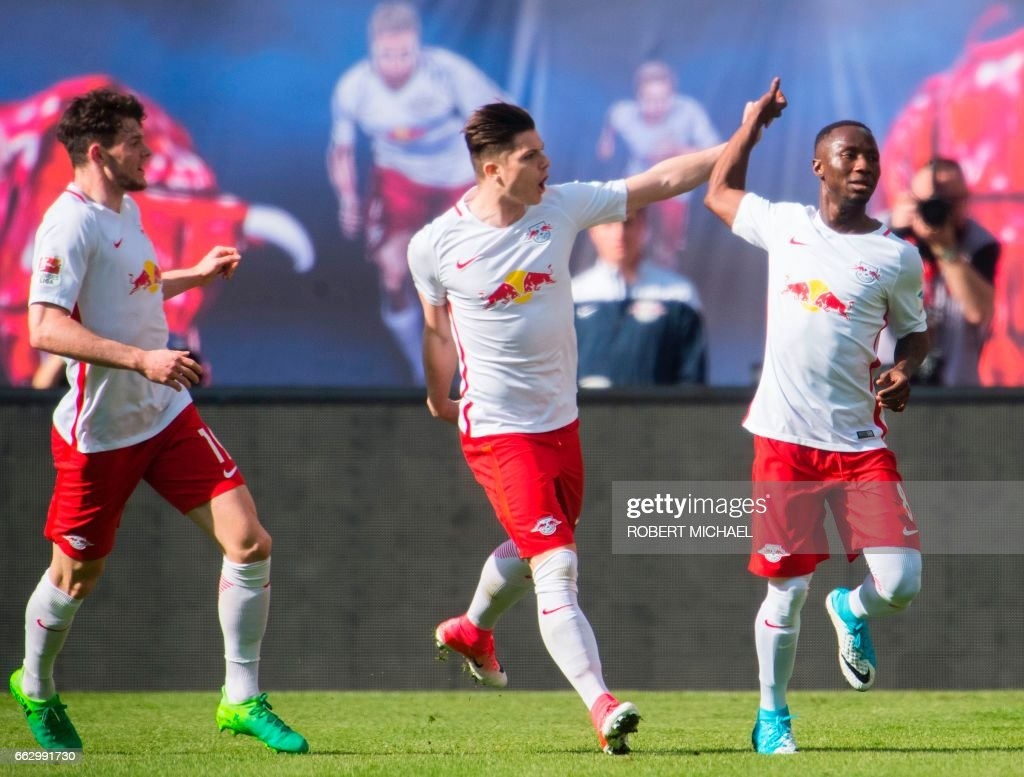 Leipzig's Guinean midfielder Naby Keita (R) is congratulated by his teammates Scottish midfielder Oliver Burke (L) and Austrian forward Marcel Sabitzer (C) after scoring the 1-0 during the German First division Bundesliga football match between RB Leipzig and SV Darmstadt 98 in Leipzig, on April 1, 2017. /