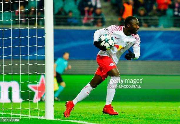 Leipzig's Guinean midfielder Naby Keita runs with the ball after scoring during the UEFA Champions League group G football match RB Leipzig vs...