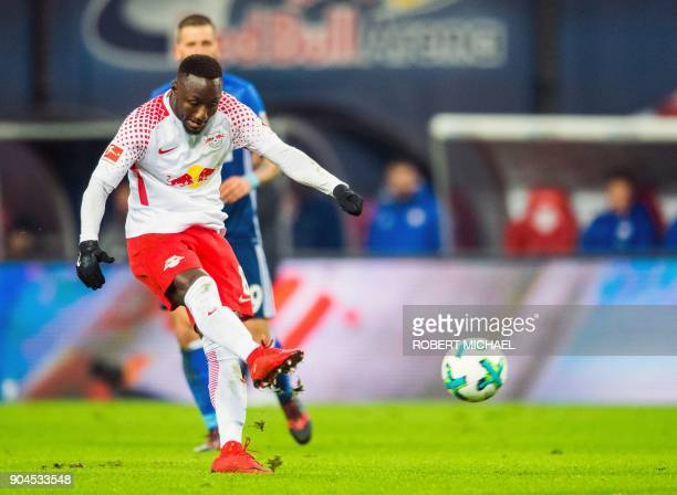 Leipzig´s Guinean midfielder Naby Keita scores the opening goal during the German first division Bundesliga football match between RB Leipzig and FC...