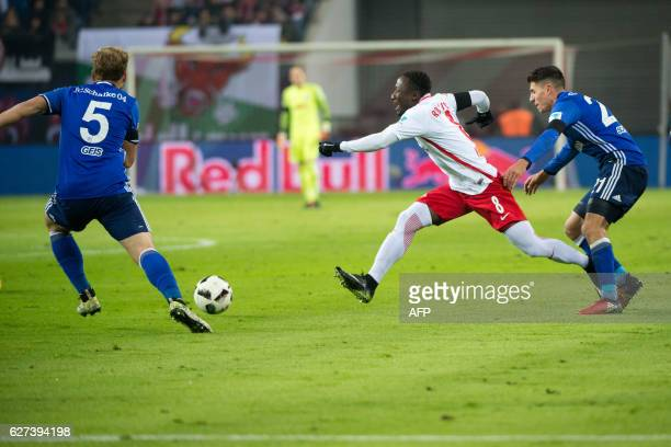Leipzig's Guinean midfielder Naby Keita vies for the ball with Schalke's midfielder Johannes Geis and Schalke's Austrian midfielder Alessandro...