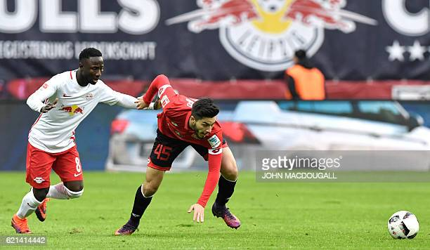 Leipzig's Guinean midfielder Naby Keita vies with Mainz' midfielder Suat Serdar during the German first division Bundesliga football match between RB...