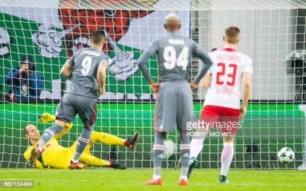 Leipzig's Hungarian goalkeeper Peter Gulacsi fails to save a penalty by Besiktas Spanish forward Alvaro Negredo during the UEFA Champions League...